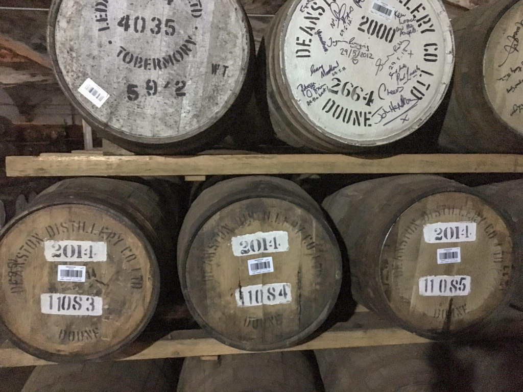 aging barrels of whisky in deanston whisky distillery scotland