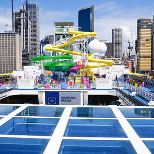 Carnival Splendor Waterslides with Sydney buildings in background