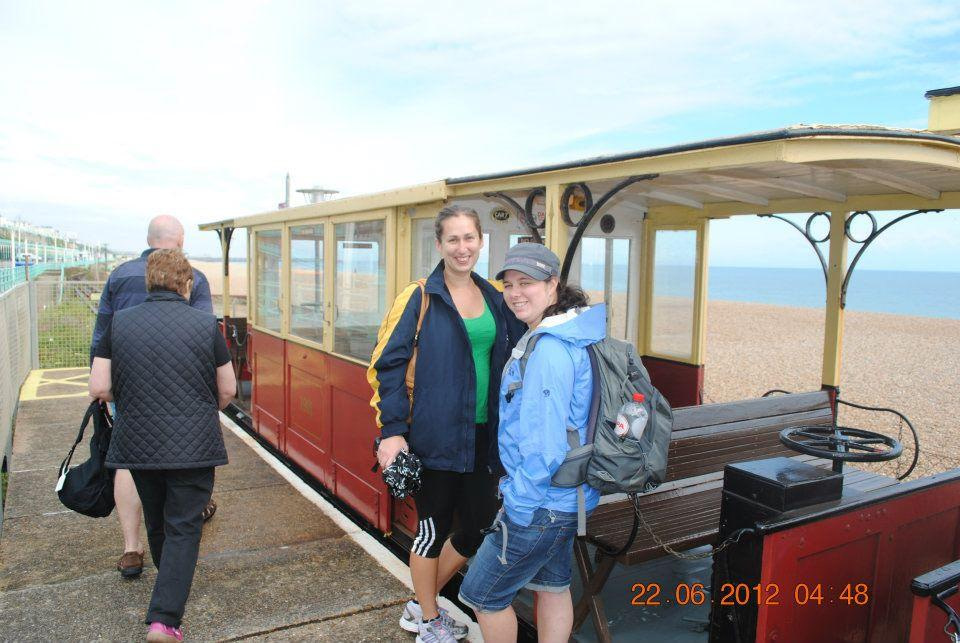 four adults boarding Volks Railway train at Brighton Pier