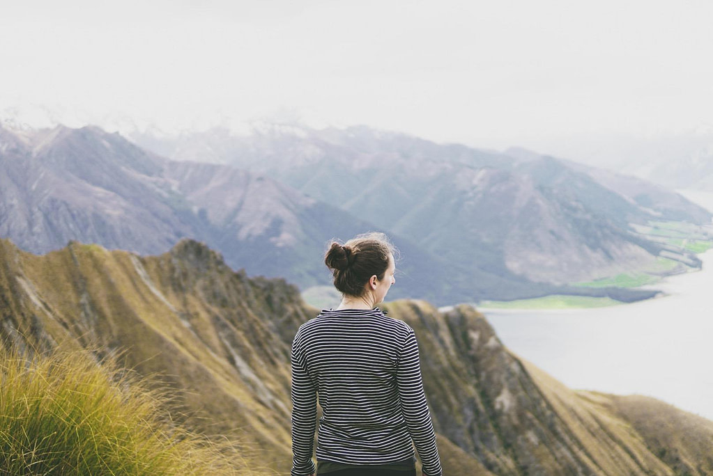 Woman looking at view from halfway up Isthmus Peak