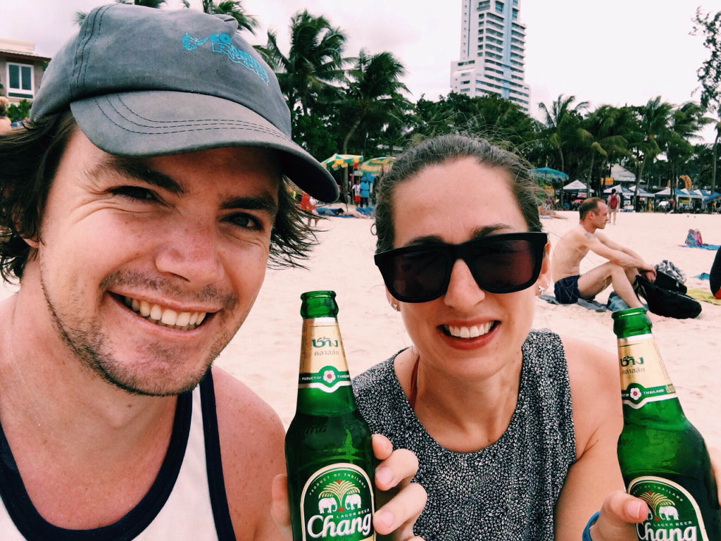 Couple drinking beer on beach when visit Patong Beach Phuket