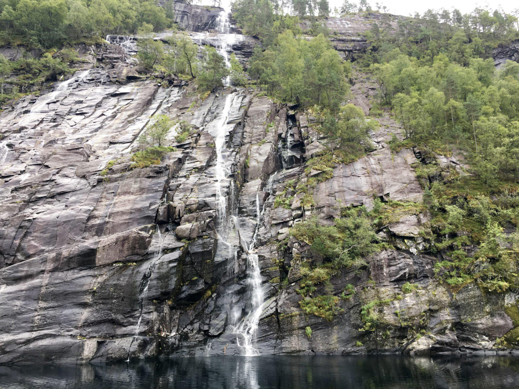 waterfall fjords from a cruise boat from bergen norway
