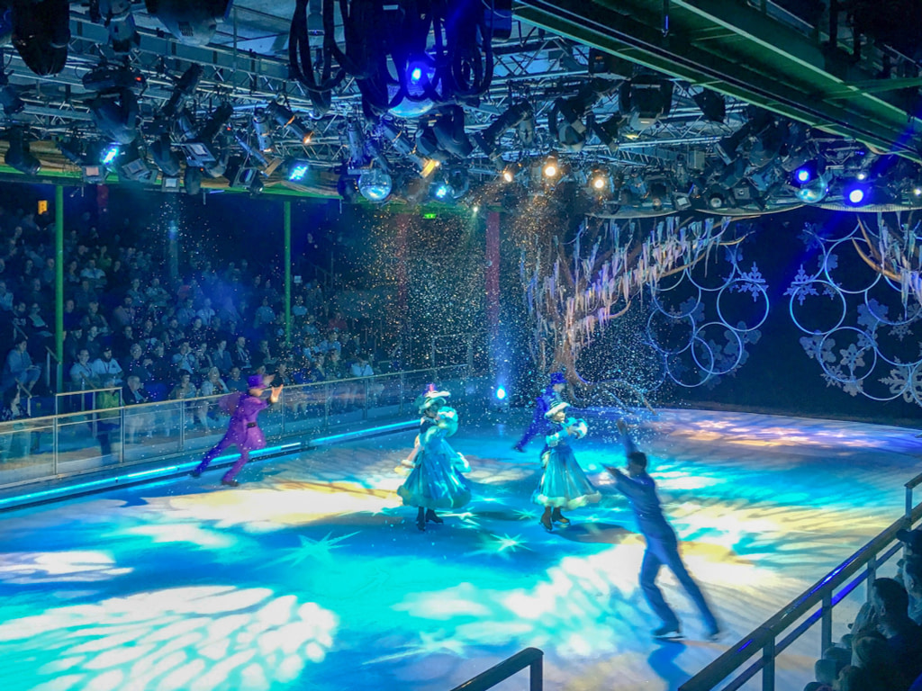 ice skaters perform on board a cruise ship