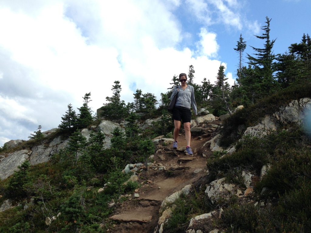 young woman hiking whistler in summer