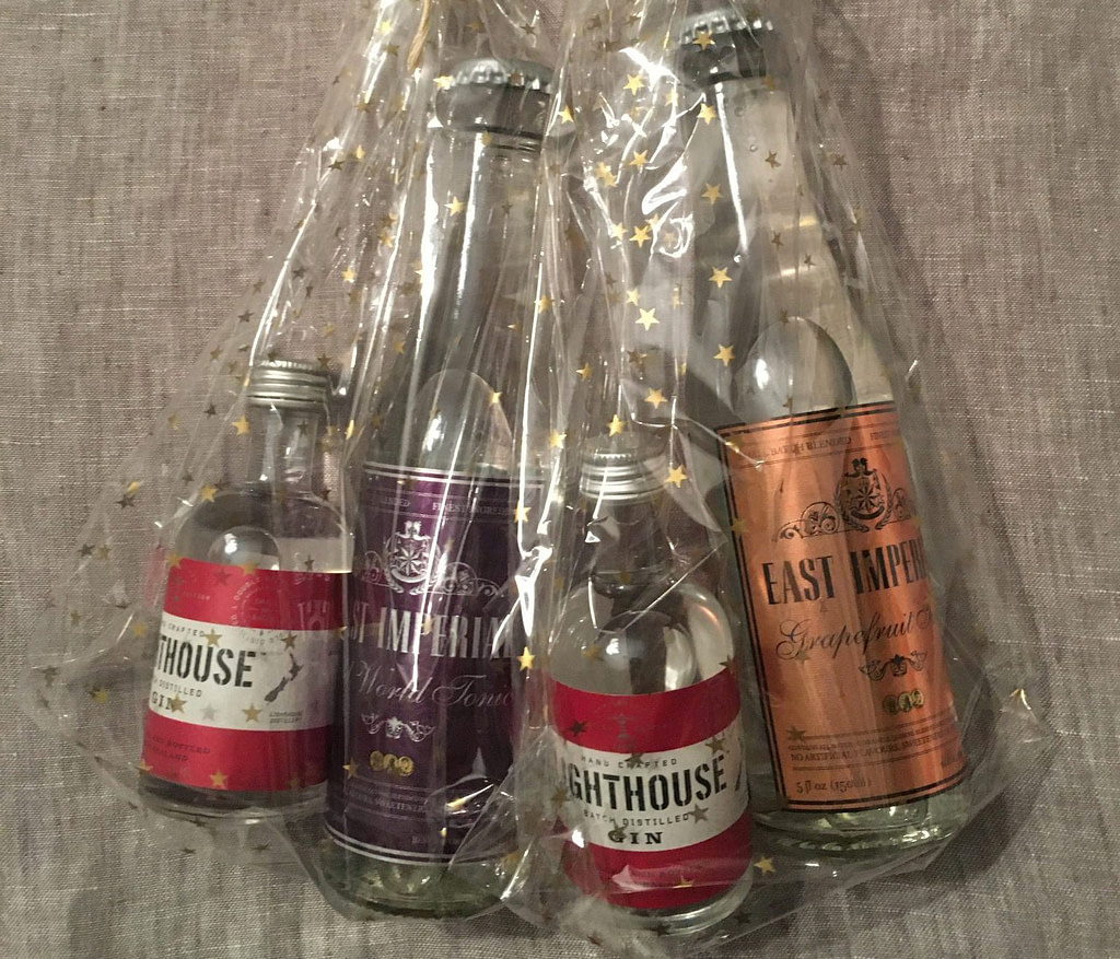 two 50ml Lighthouse gin bottles each pacakged with a small bottle of East Imperial tonic water