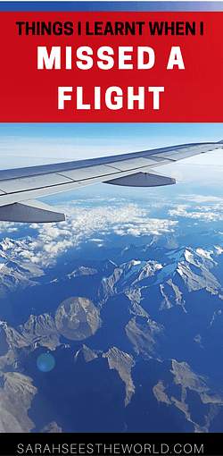 plane wing over mountains
