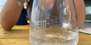 reid + reid branded glass containing gin and tonic