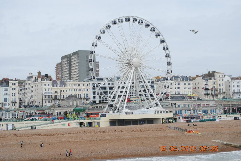 brighton beach wheel and city viewed from pier during a weekend in brighton
