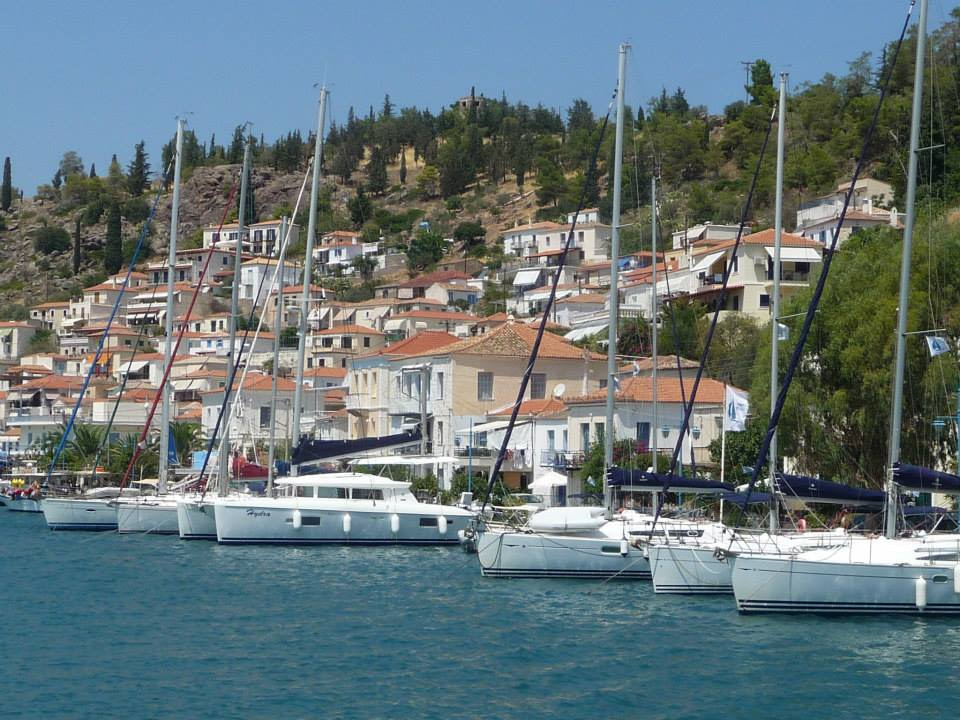 poros shore with boats and buildings from a yacht