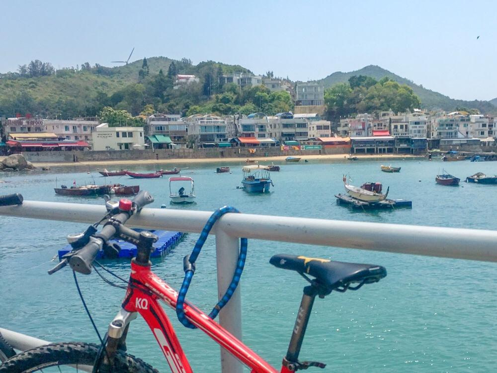 view of bike and lamma island fishing boats from ferry terminal