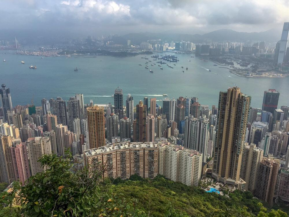 skyscrapers view from morning trail on the peak in hong kong