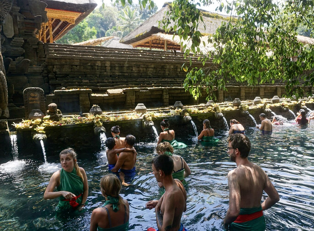 tourists in water at temple in ubud bali