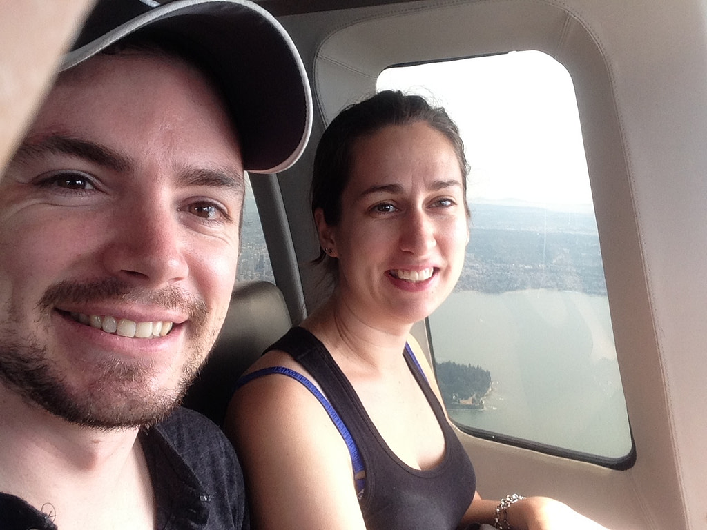 Young man and young woman in helicopter over Vancouver Canada