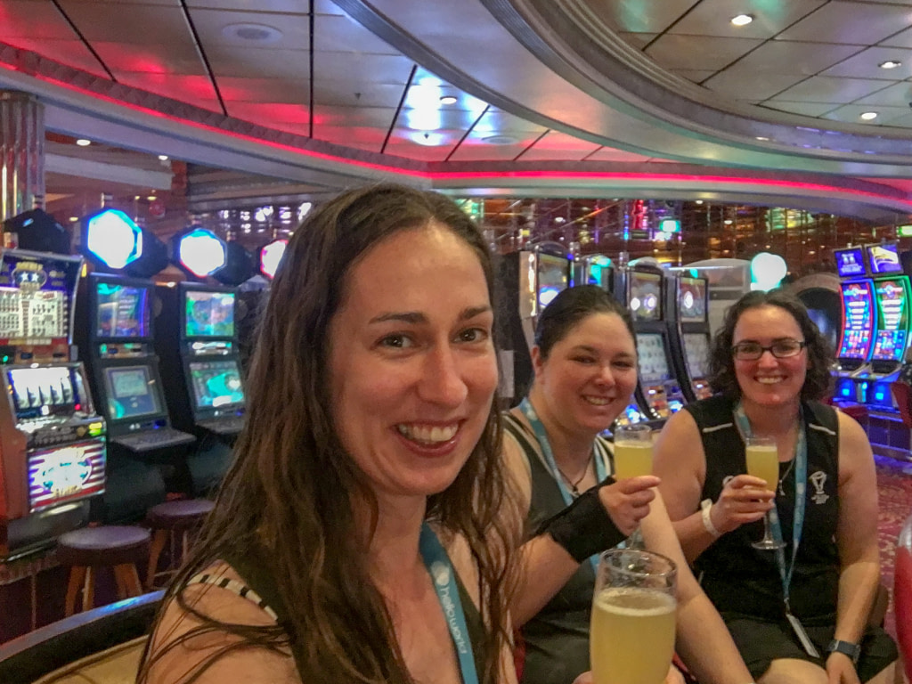 three young women drinking mimosas in a casino