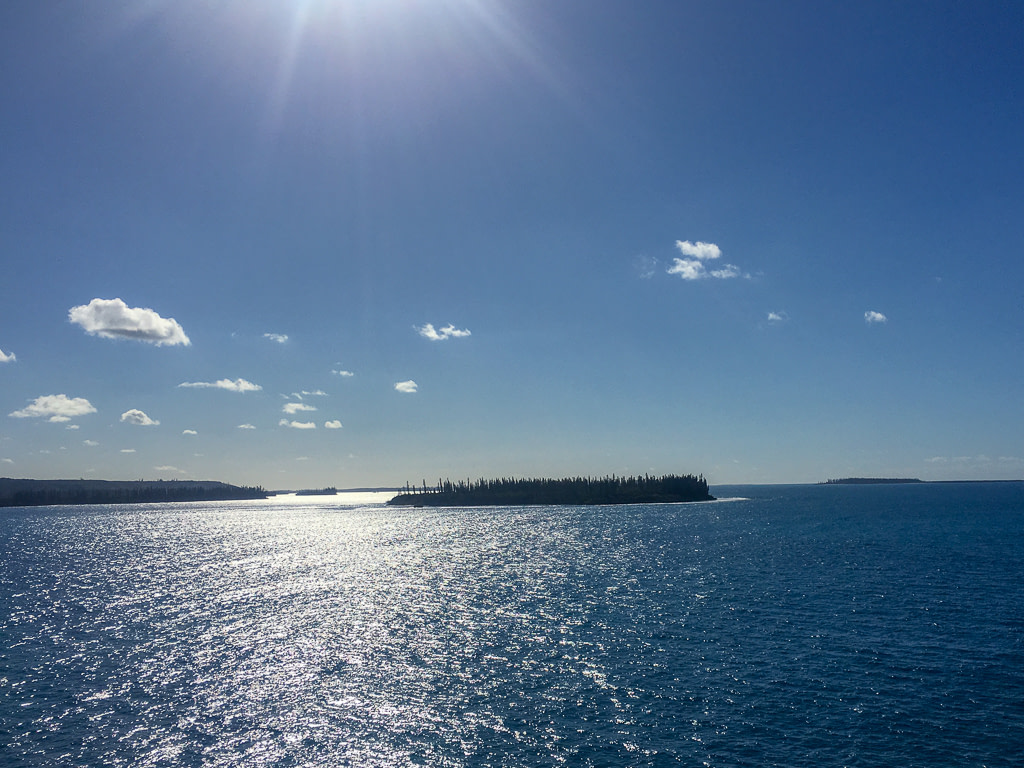Brush Island (centre) and Isle of Pines New Caledonia (left)