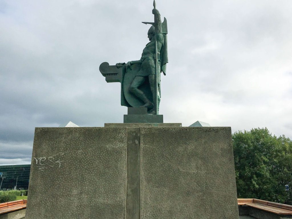 statue of viking holding sword vertically in Reykjavik Iceland