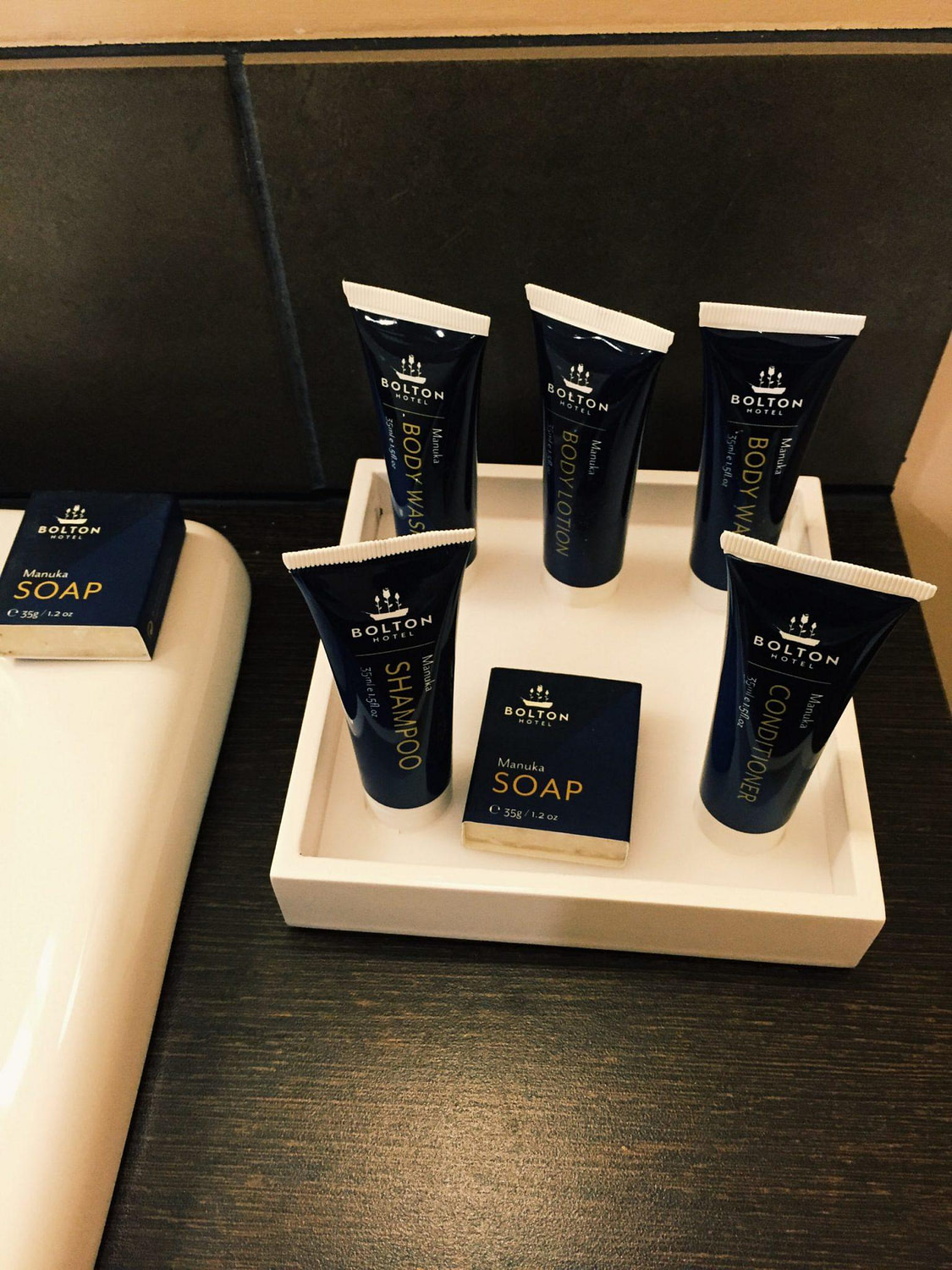 Conditioner, shampoo, body lotion and soap from The Bolton Hotel Wellington Amenities