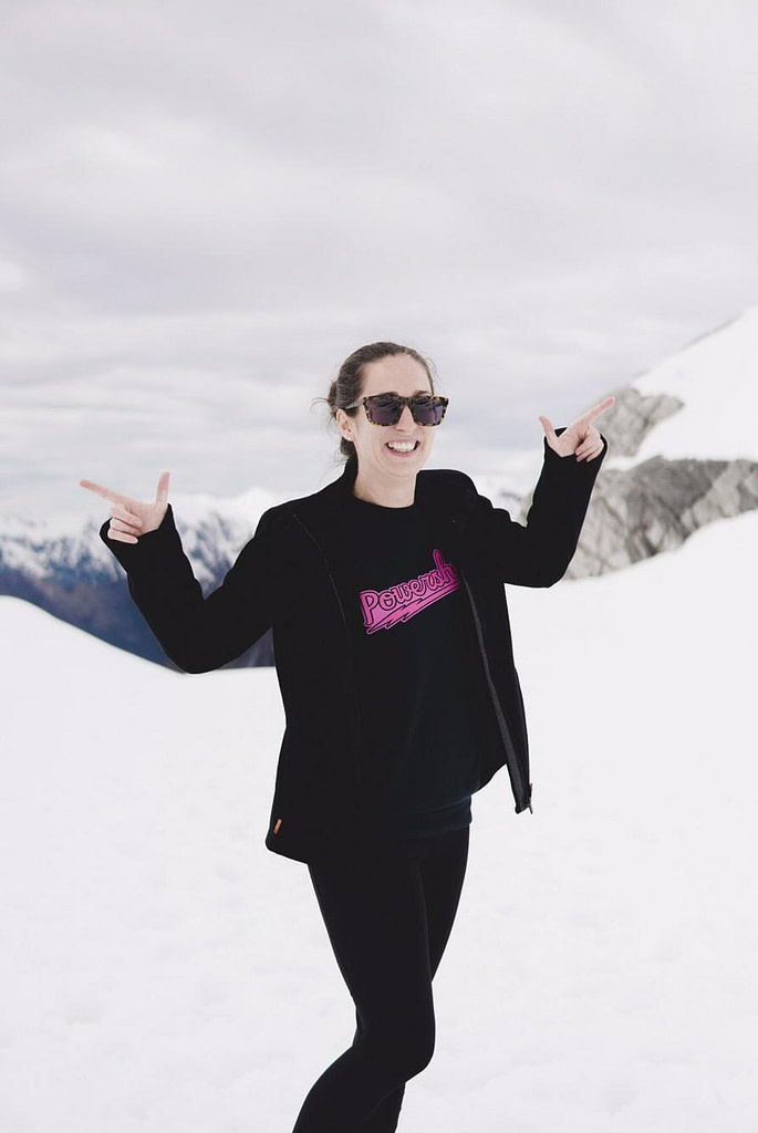girl on snowy glacier Franz Josef helicopter flight