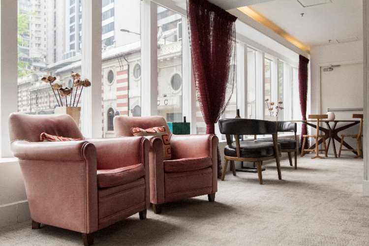 two pink arm chairs in lobby at mini hotel central hong kong