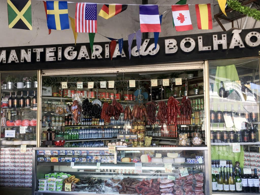 upstairs market in Porto with cured meats, wine and bunting