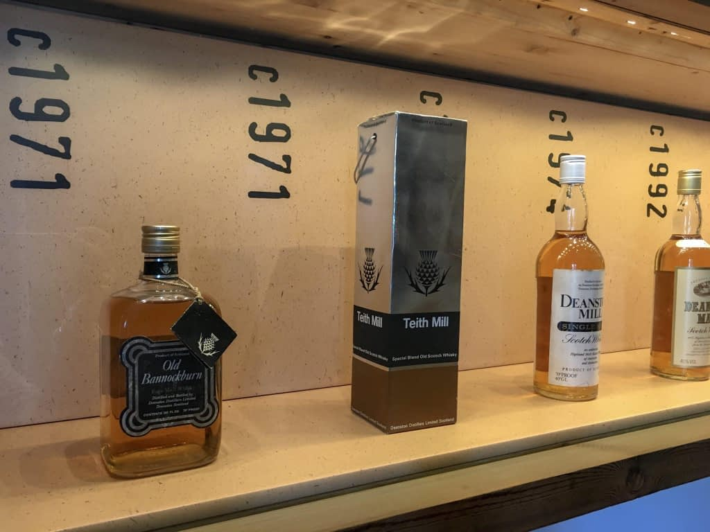 bottles of whisky and years made on shelf